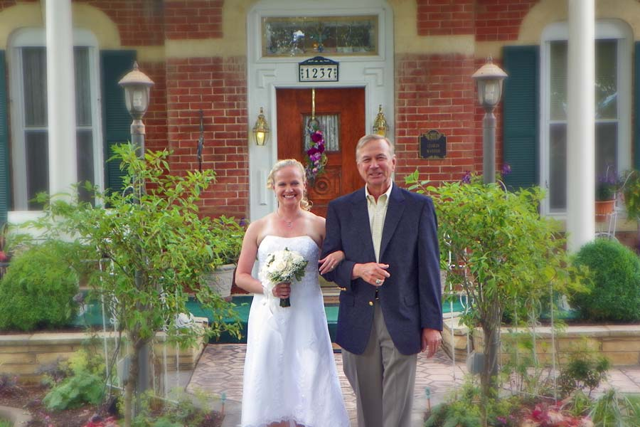 father and bride in front of Cloran