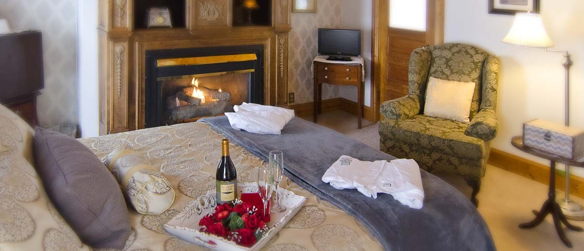 fireplace and wine tray in luxury guest room