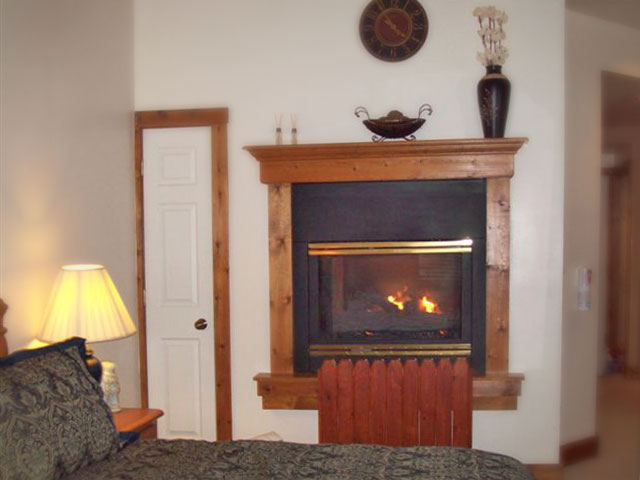 Cloran Condo bed and fireplace
