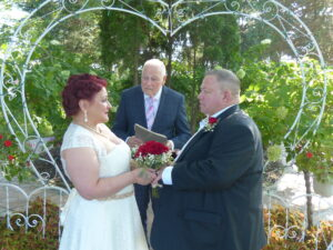 Jess Farlow marries Pamela and Stoney in an outdoor ceremony