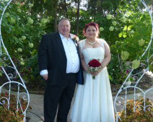 Stoney and Pamela pose outside after the wedding ceremony