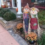 Small scarecrows outside entrance at Cloran Mansion