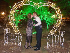 Amanda and Brian kiss under the heart outside the Cloran Mansion